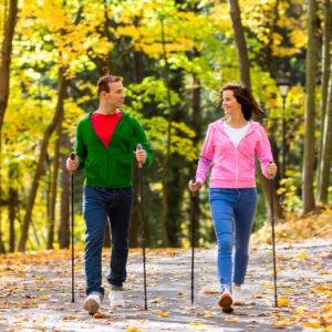 Man and woman doing Nordic walking