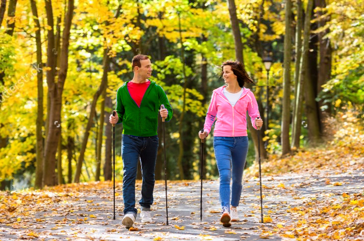 Man and woman doing Nordic walking