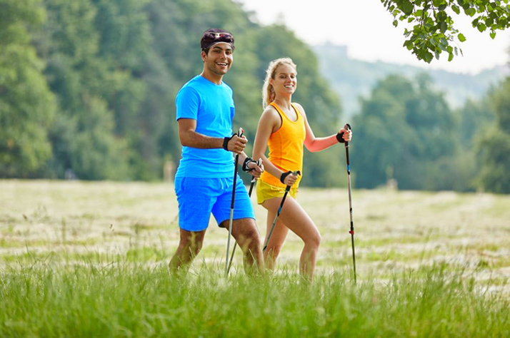 Couple doing Nordic walking, great for bone health.