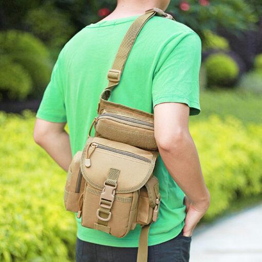 Man holding waist drop belt leg bag - tan